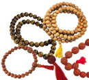 Mala beads and bracelets made of wooden seed and stone